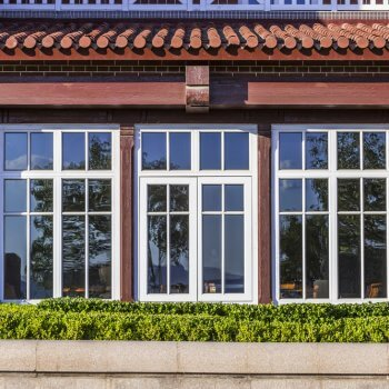 casement windows in a brick house